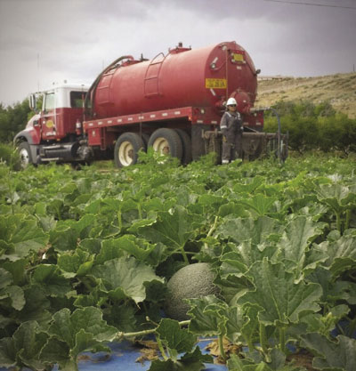 A truck delivers water to a field in San Juan County after the Gold King Mine spill.